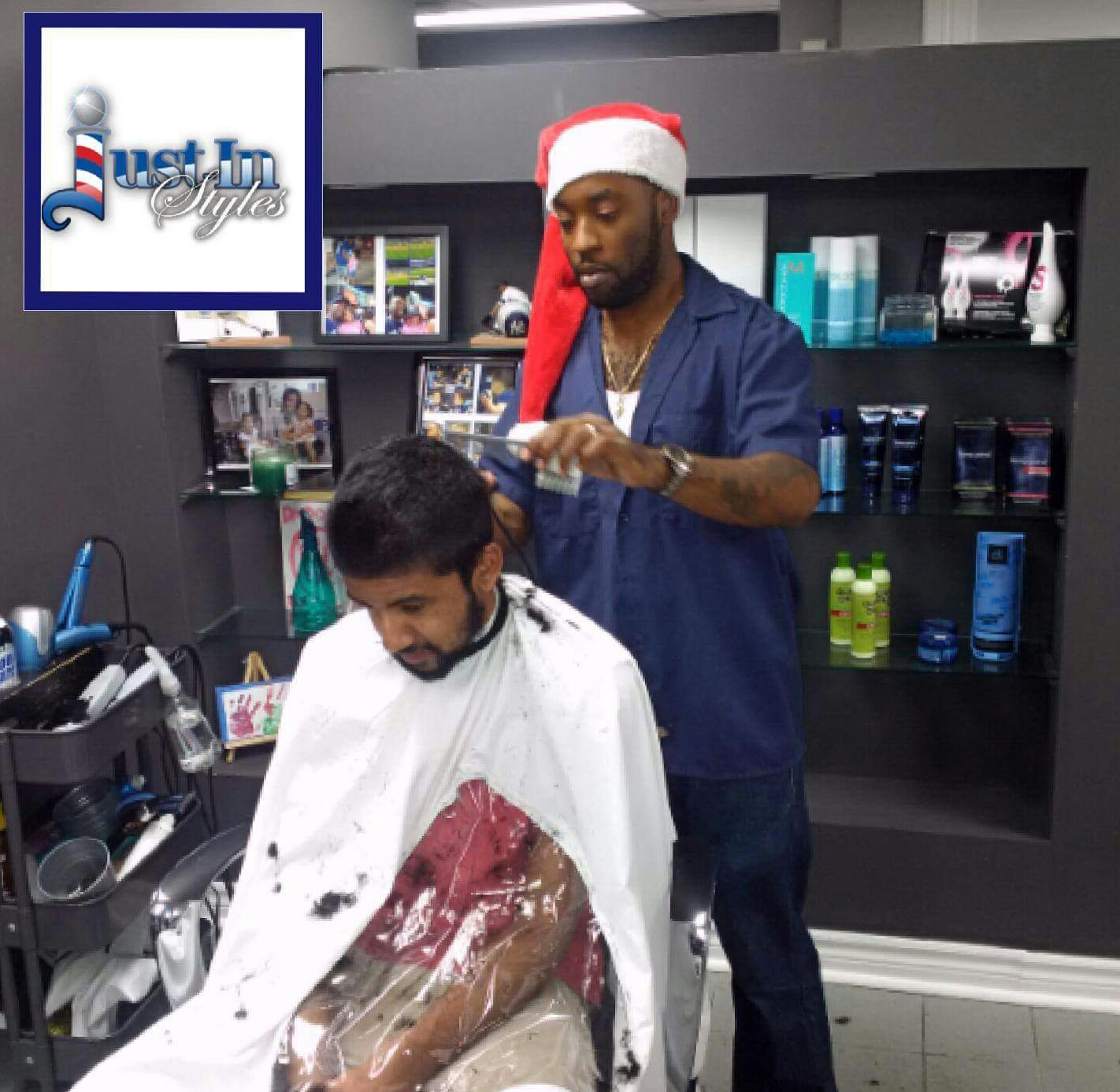 Santa Styles Stunts His Bag of Gifts at The Barber Workshop This Past Holiday Season